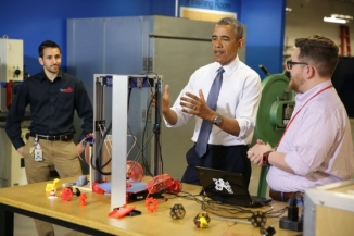 President Barack Obama is shown a 3-D printer by Andy Leer, right, during a tour of TechShop Pittsburgh, a community-based workshop and prototyping studio in Pittsburgh, Pa., June 17, 2014. Watching at left is General Manger Matt Verlinich. (Official White House Photo by Chuck Kennedy)