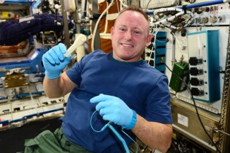 Commander Barry Wilmore with the 3D-printed wrench. (photo courtesy of NASA)